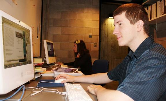 A young man working at a computer