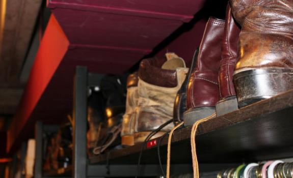 A row of boots on a shelf