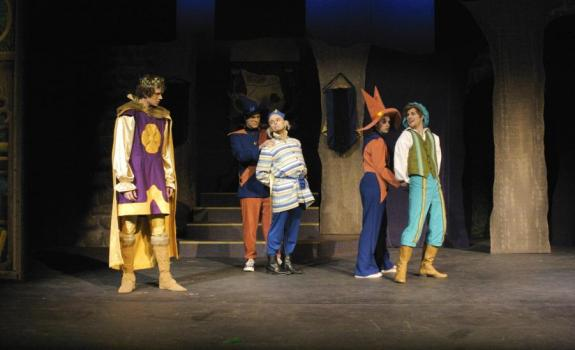 A group of actors in bright costumes