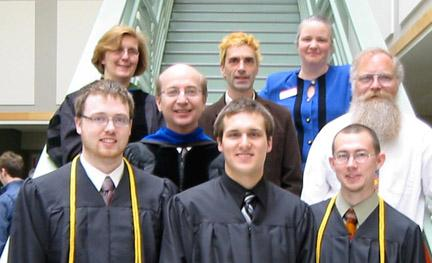 Graduates lined up on a stairwell