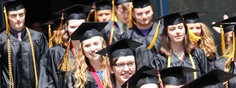 Graduates walking into Commencement ceremony