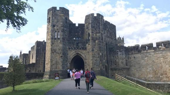 Students walking into a castle