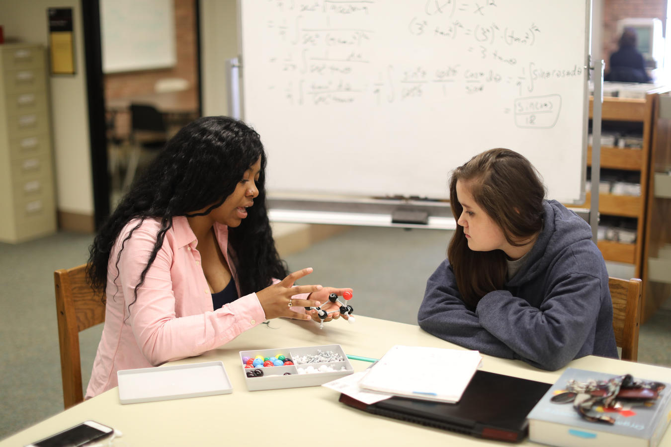 Two students engaged in a tutoring session