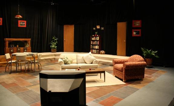 A living room set onstage