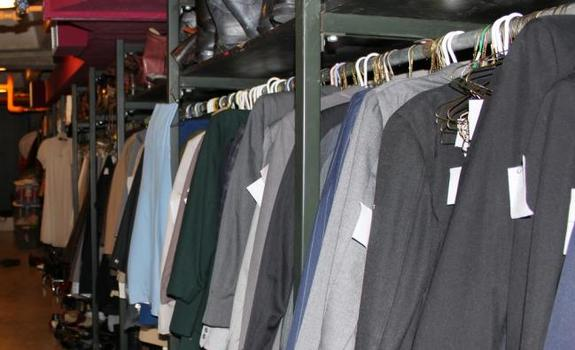 Suits hanging on a rack