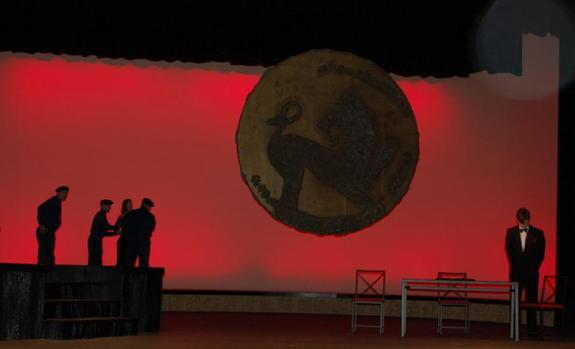 Actors in silhouette onstage