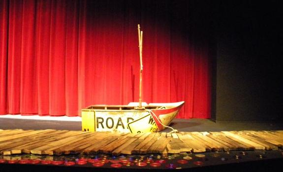 A boat sitting on a stage