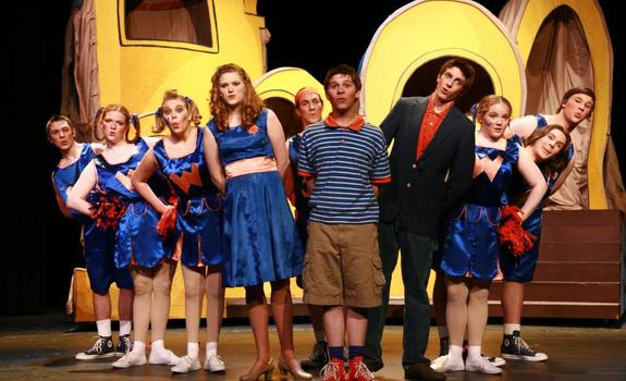 A group of actors and actresses in bright costumes