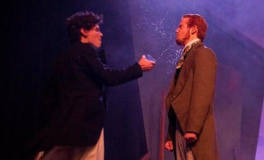 An actor throws a glass of water in another actors face